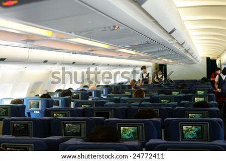 Economy Class cabin of airplane - stock photo