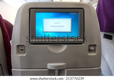 Economy class seat with entertainment system onboard. - stock photo