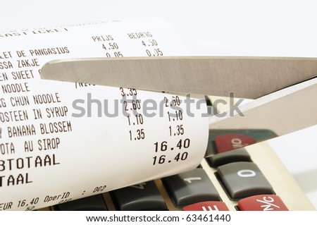 Economy concept with scissors cutting receipt from shop - stock photo