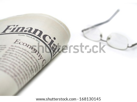 Economy newspaper with copy space on white background in shallow depth of field - stock photo