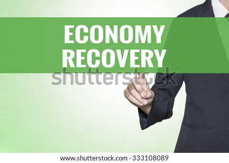 Economy Recovery word on green virtual screen touching by business woman - stock photo