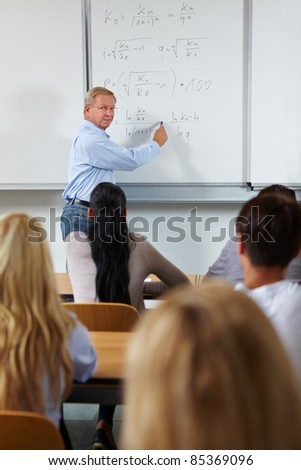 Economy study course with teacher in university - stock photo