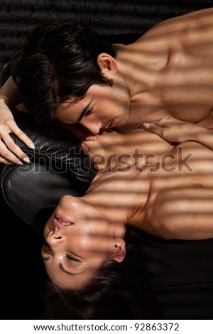 Ecstacy Of Love. Attractive young lovers enjoying sexual foreplay, facial expressions. - stock photo