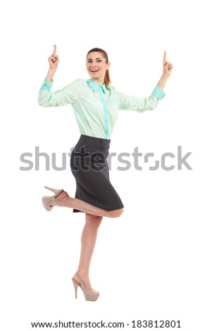 Ecstatic businesswoman. Shouting businesswoman raising hands and pointing up. Full length studio shot isolated on white. - stock photo