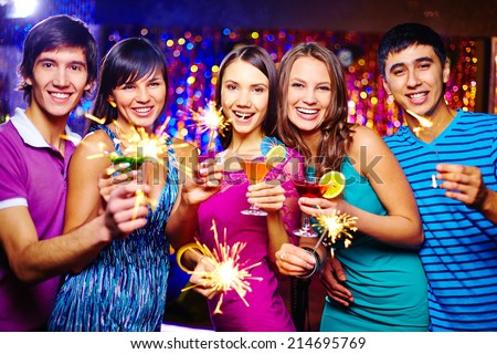 Ecstatic friends toasting at New Year party - stock photo