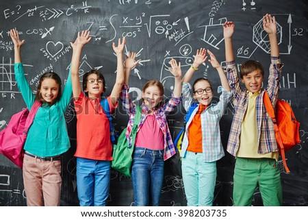 Ecstatic schoolchildren - stock photo