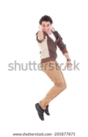 Ecstatic young casual man showing thumbs up jumping of joy and excitement, Successful proud modern guy leaping with energy - stock photo