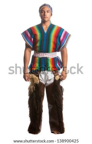 ECUADORIAN DANCER DRESSED UP IN TRADITIONAL COSTUME FROM THE HIGHLANDS, LLAMA OR ALPACA PANTS STUDIO SHOT ISOLATED ON WHITE