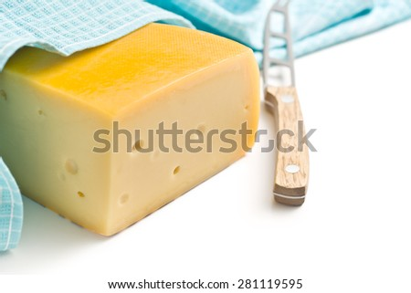 edam cheese and knife on white background - stock photo