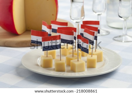 Edam cheese snacks with flags and Dutch gin - stock photo