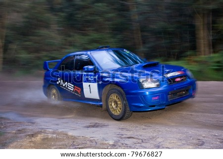EDEN - JUNE 12, 2011: Michael south and Julie Boorman on their way to an overall win at the Bega Valley Rally also winning the NSW rally Championship, June 12, 2011, Eden, NSW, Australia. - stock photo