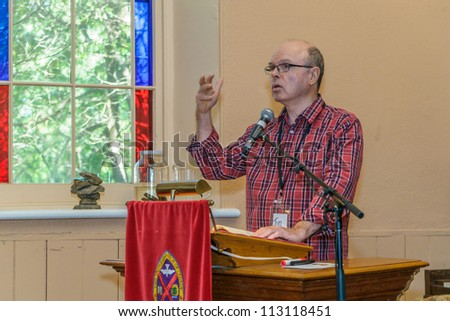 EDEN MILLS, ON - SEPTEMBER 16:  Prize winning Canadian writer, Tim Liburn, reads  from his recent book at the annual Writers Festival in Eden Mills, Ontario on September 16, 2012. - stock photo
