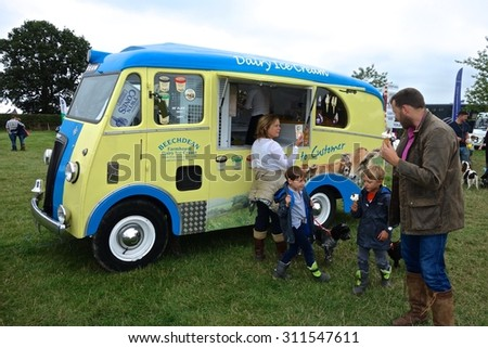 Edenbridge, Kent, England - AUGUST 30: Vintage ice cream van dispensing ices to visitors to the Edenbridge & Oxted Agricultural Show, Edenbridge, Kent, England. August 30, 2015 in Edenbridge, England. - stock photo