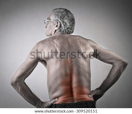 Ederly man suffering from backache - stock photo