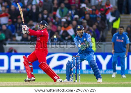 EDGBASTON, ENGLAND - June 23 2013: James Tredwell and Mahendra Singh Dhoni during the ICC Champions Trophy final cricket match between England and India at Edgbaston Cricket Ground - stock photo