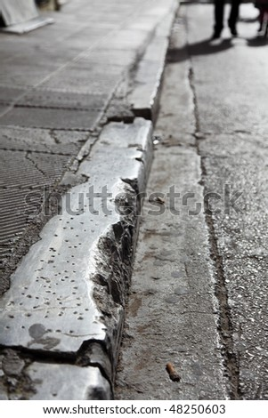 Edge a stone separating sidewalk from road - stock photo