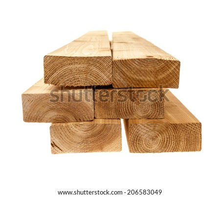 Edge of six cedar two by four lumber boards stacked on white background - stock photo