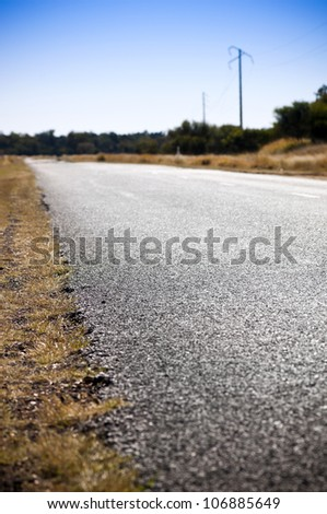 Edge of the road in shallow focus for road safety concept - stock photo
