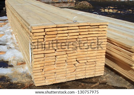 Edging board in stacks. - stock photo