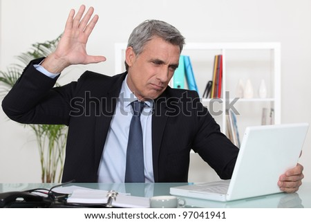 edgy business man - stock photo