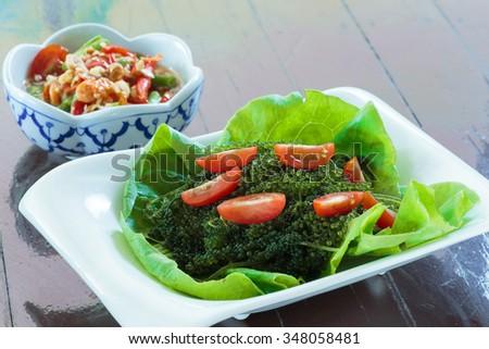 Edible seaweed salad, grapes eye. - stock photo