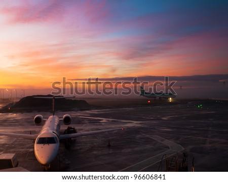 Edinburgh airport sunset - stock photo