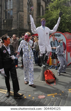 EDINBURGH- AUGUST 8: Members of Gardyloo publicize their show The Dream Sequentialists during Edinburgh Fringe Festival on August 8th, 2015  - stock photo