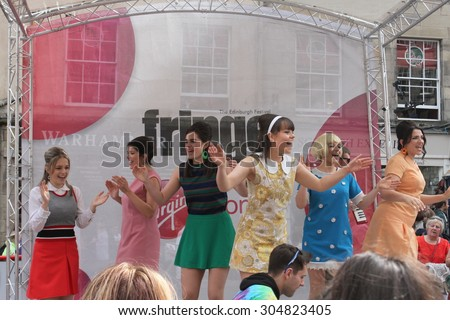 EDINBURGH - AUGUST 8: Members of Max Emmerson Productions publicize their show Shout! The Mod Musical during Edinburgh Fringe Festival on August 8, 2015 in Edinburgh, Scotland - stock photo