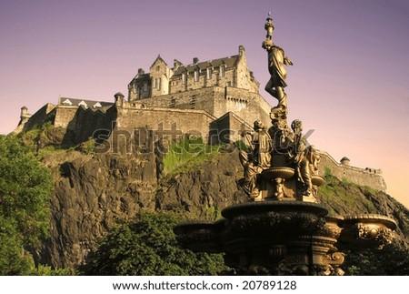 Edinburgh Castle at dusk from Princes St Gardens - stock photo