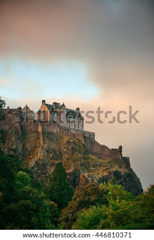 Edinburgh castle at sunset as the famous city landmark. United Kingdom. - stock photo