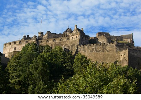 Edinburgh Castle atop Castle Rock in Edinburgh Scotland. - stock photo