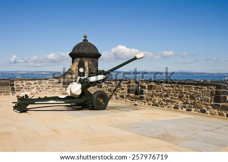 Edinburgh castle cannon in sunny summer day without people - stock photo