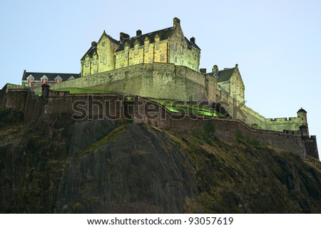 Edinburgh Castle, illuminated at nightfall, in winter from the north west. - stock photo
