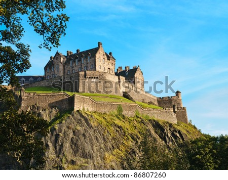 Edinburgh castle over clear blue sky, Scotland, UK - stock photo