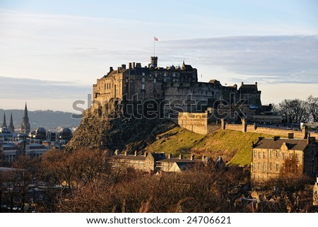 Edinburgh Castle, Scotland, from the south east, in the late afternoon, the facade catching the golden winter light - stock photo