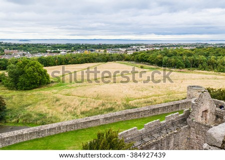 Edinburgh city skyline from Craigmillar Castle, Scotland. United Kingdom - stock photo
