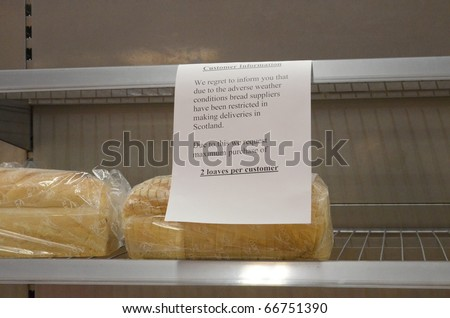 EDINBURGH - DECEMBER 7: a sign warns customers of limited stocks of bread at an Asda Walmart superstore on December 7th, 2010 in Edinburgh, Scotland. Deliveries are being disrupted due to the weather. - stock photo
