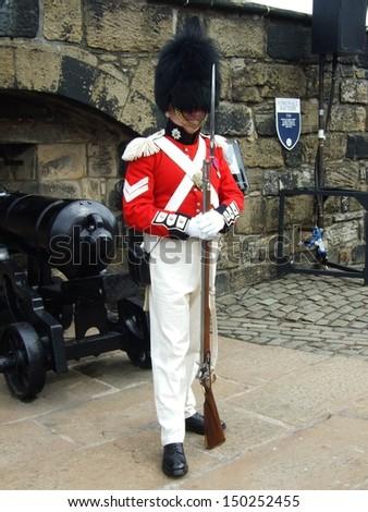 EDINBURGH, GREAT BRITAIN - CIRCA AUGUST 2007: Unknown soldier stands guard in the castle circa August 2007 in Edinburgh, Great Britain. - stock photo