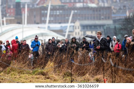 EDINBURGH - JANUARY 9: spectators observen the Great Edinburgh Cross Country event on January 9, 2016 in Edinburgh, Scotland. Edinburgh hosts the athletics event annually in January. - stock photo