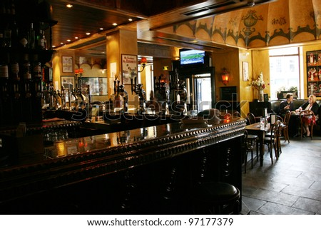 EDINBURGH - JULY 23: Interior of pub, for drinking and socializing, focal point of the community, on July 23, 2010, Edinburgh, UK. Pub business, about 53,500 pubs in UK, has been declining every year - stock photo
