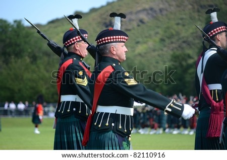EDINBURGH - JULY 2: Unidentified soldiers participate in a parade on July 2, 2011 in Edinburgh, Scotland. Queen Elizabeth II presented new Colours to the soldiers following the parade.