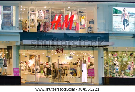 EDINBURGH - JUNE 1: exterior of an H&M clothing store on June 1, 2014 on Princes Street in Edinburgh, United Kingdom. H&M exists in 57 countries with over 3,500 stores and employs c.132,000 people. - stock photo