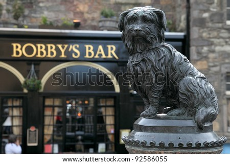 EDINBURGH - JUNE 07 : Life-size statue of Greyfriars Bobby a Skye Terrier who spent 14 years guarding the grave of his owner, John Gray, until he died on 14 January 1872 on June 07, 2009 in Edinburgh. - stock photo