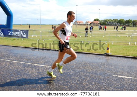 EDINBURGH - MAY 22: Unidentified athlete competes in the Edinburgh Marathon on May 22, 2011 in Edinburgh, United Kingdom. The Edinburgh Marathon has more entrants than any other marathon event in Scotland. - stock photo