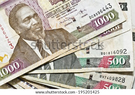 EDINBURGH, SCOTLAND JANUARY 11, 2014: photo of Kenyan Shilling banknotes in Edinburgh, Scotland. The Shilling is the currency of Kenya and is divisible into 100 cents. - stock photo