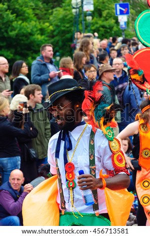 EDINBURGH, SCOTLAND - JULY 17, 2016: Closeup of a male performer in the Carnival of The Edinburgh Jazz and Blues Festival travelling down the Mound towards Princes Street