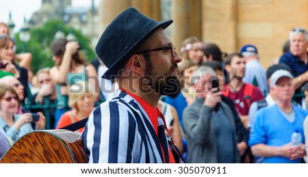 EDINBURGH, SCOTLAND - JULY 19, 2015: Musician in the Edinburgh Jazz & Blues Festival Carnival, Parade from the Mound to Princes Street, performances in Princes Street Gardens and the Grassmarket