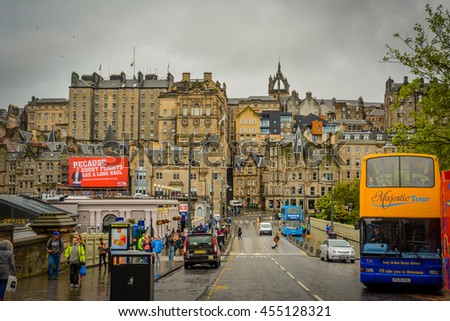 EDINBURGH, SCOTLAND - JUNE 16, 2016: The city center of Edinburgh after rain. With DOF technique, only the front objects are in focus while the distant objects and background are blur. - stock photo