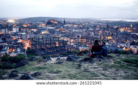 EDINBURGH, SCOTLAND - MAY 06, 2014: Couple on hill in Edinburgh. Edinburgh is the capital city and second most populous city in Scotland. - stock photo