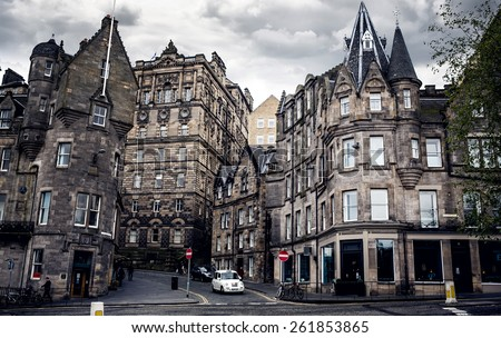 EDINBURGH, SCOTLAND - MAY 06, 2014: Edinburgh's busy Royal Mile (The Highstreet) is one of the most iconic streets in Scotland and a major tourist attraction - stock photo